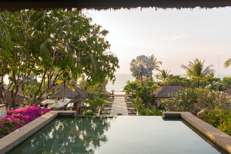 Beautiful tropical resort and spa during sunset time in Bali, Indonesia Stock Photo