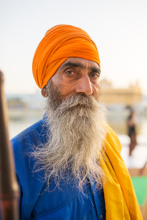 Amritsar, India - March 29, 2016: Portrait of Indian sikh man in turban with bushy beard in Golden temple in Amritsar