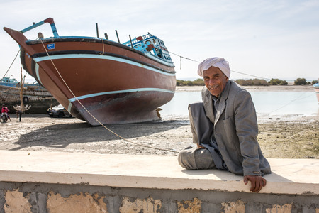 middle ages boat: Qeshm island, Iran - December 20, 2015: Portrait of the unidentified iranian man on Qeshm island.