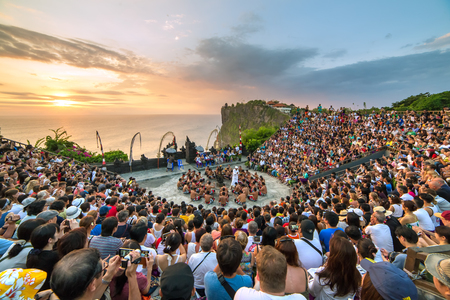 chant: Bali, Indonesia - September 19: Tourists watch traditional Balinese Kecak Dance at Uluwatu Temple on Bali, Indonesia. Kecak (also known as Ramayana Monkey Chant) is very popular cultural show on Bali. Editorial
