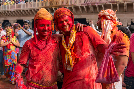 smeared: Nandgaon, India - March 18, 2016: Two unidentified men with face smeared with colors during Holi celebration in Nandgaon, Uttar Pradesh, India.
