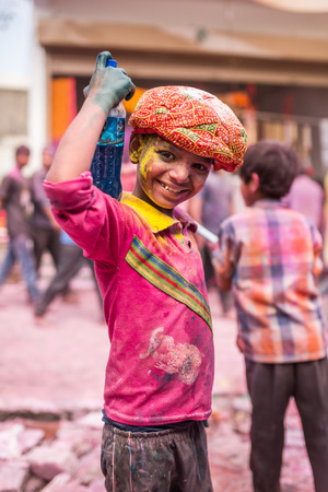 Barsana, India - March 17, 2016: Kids celebrate Lathmar Holi in Barsana village, Uttar Pradesh, India. Editorial