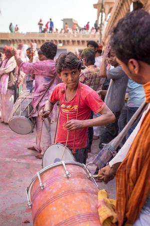 Nandgaon, India - March 17, 2016: Devotees celebrate Lathmar Holi in Nandgaon village, Uttar Pradesh, India. Editorial