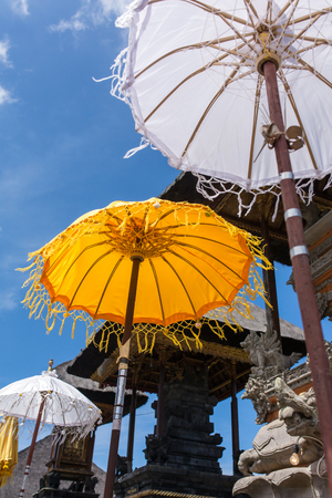Traditional Hindu umbrellas in temple, Bali, Indonesia Stock Photo - 75178991