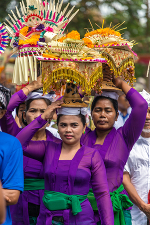 processions: Bali, Indonesia - July 16, 2016: Unidentified balinese women with offerings during ceremony of royal cremation in Ubud, Bali Editorial