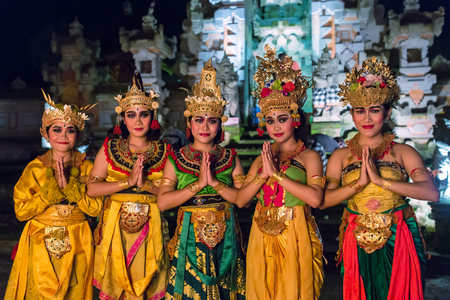 Ubud, Indonesia - August 8, 2016: artists of a traditional balinese Kecak Fire Dance posing for photo.