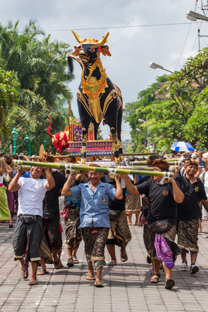 public offering: Bali, Indonesia - July 16, 2016: Balinese people participating in royal cremation ceremony in Ubud, Bali.