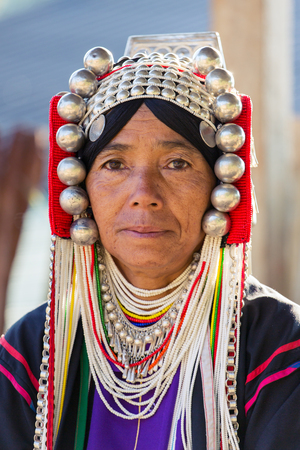 Chiang Rai, Thailand - February 8, 2017: Portrait of an unidentified Akha woman with traditional clothes and silver jewelery in Akha hilltribe village in Northern Thailand