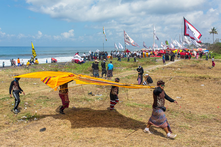 Bali, Indonesia - July 31, 2016: Traditional kite competion at Sanur Beach in Bali, Indonesia