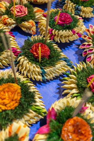 sorts: Krathong, the hand crafted floating candle made of floating part decorated with green leaves colorful flowers and many sorts of creative materials for sale on festival Loy Krathong in Chiang Mai, Thailand