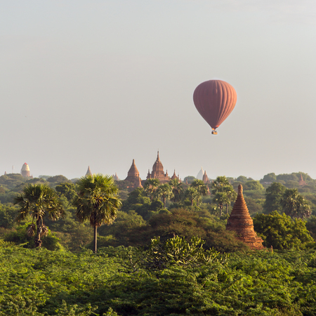Air balloons over Buddhist temples at sunrise in Bagan, Myanmar.