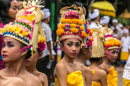 Bali, Indonesia - September 17, 2016: Unidentified balinese young artists preparing for Galungan celebration in Ubud, Bali. Editorial