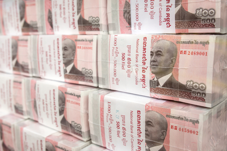 Phnom Penh, Cambodia - March 28, 2017: Stacks of 100 riel banknotes from Cambodia Editorial