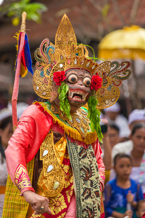 puppets: Unidentified balinese people performing in traditional masks during Galungan celebration in Ubud, Bali