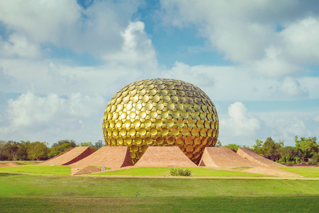 spiritual architecture: Matrimandir - Golden Temple in Auroville, Tamil Nadu, India. Vintage color filter applied Stock Photo