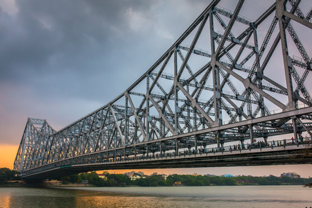 Howrah bridge on the river Hooghly during sunset in Kolkata, India Stock Photo