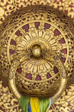 Beautiful golden door handle in the Rumtek Monastery in Gangtok, india. Architecture detail close-up