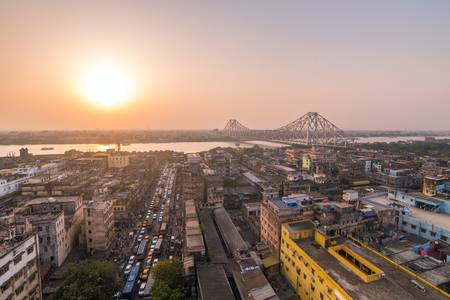 Aerial view of Kolkata city, India. Beautiful sunset over the famous Howrah bridge - The historic cantilever bridge on the river Hooghly, Calcutta, India.