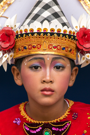 Bali, Indonesia - September 17, 2016: Portrait of an unidentified balinese young artist ready for Galungan celebration in Ubud, Bali. Editorial