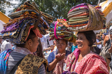 Bali, Indonesia - August 20, 2016: Balinese vendors selling sarongs during public cremation in Ubud, Bali, Indonesia. Redakční