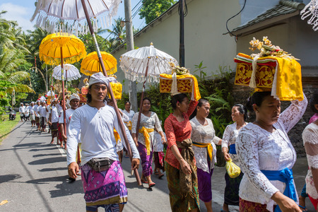 Bali, Indonesia - September 16, 2016: Traditional balinese procession during Galungan celebration in Ubud, Indonesia Stock Photo - 111543243