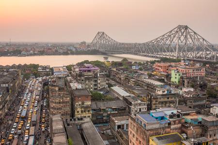Kolkata, India - April 13, 2017: Beautiful view of Kolkata city with a Howrah bridge on the river Hooghly during sunset.