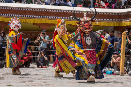 Leh, India - June 21, 2017: Unidentified monk in mask perform a religious masked and costumed mystery dance of Tibetan Buddhism during the Buddhist festival at Hemis monastery, Ladakh.