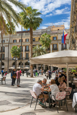 Barcelona, Spain - March 27, 2018: Outdoor restaurants at famous Placa Reial in Barcelona, Spain Redakční