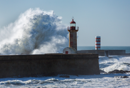 Waves crashing on Lighthouse in Foz of Douro, Portugal