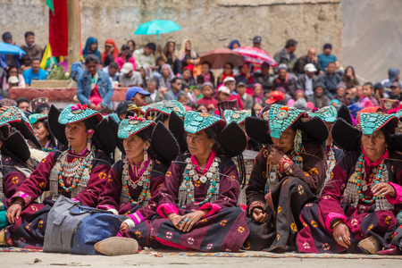 Lamayuru, India - June 19, 2017: Unidentified Zanskari women wearing ethnic traditional Ladakhi headdress with turquoise stones called Perakh Perak, Ladakh, India Sajtókép