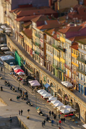 Porto, Portugal - January 15, 2018: Beautiful colorful houses on the riverside of Douro river in the Old town of Porto, Portugal. Tilt-shift effect applied