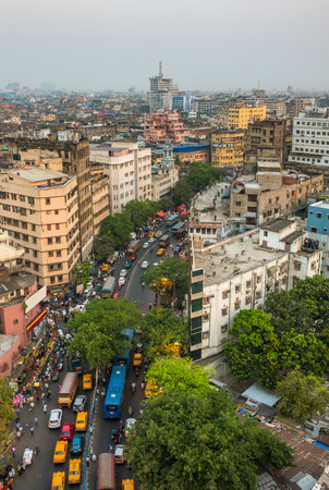 Kolkata city traffic on the crowded street in downtown, West Bengal, India. Top view Editorial