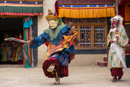 Lamayuru, India - June 21, 2017: Unidentified monk in mask perform a religious masked and costumed mystery dance of Tibetan Buddhism during the Yuru Kabgyat Buddhist festival at Lamayuru Gompa, Ladakh.