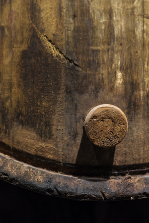 Cork of a wooden porto wine barrel in wine cellar of Porto, Portugal. Stok Fotoğraf