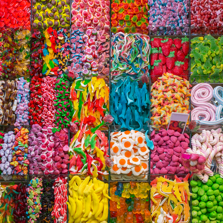 Assorted gummy candies in the shop. Top view. Jelly sweets.