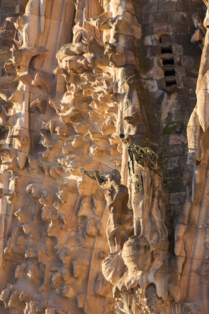 Barcelona, Spain - March 26, 2018: La Sagrada Familia - the impressive cathedral designed by Gaudi, which is being build since 19 March 1882 and is not finished yet, Barcelona, Spain. Details of the f