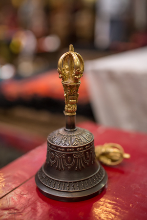 Buddhist religious equipment - Vajra Dorje and bell. Close up view in tibetan buddhist monastery in Ladakh