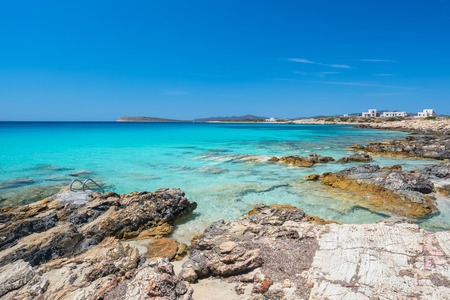 Rocky beach with amazing tranquil water on Paros island, Cyclade Imagens