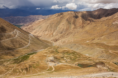 Mountain road climbing up to the pass in Himalaya mountains in Ladakh