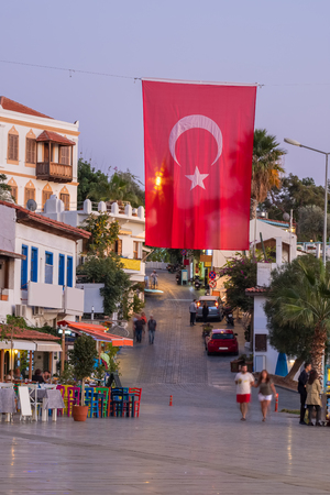 Turkish national flag on the main square in mediterranean town Kas in Turkey.