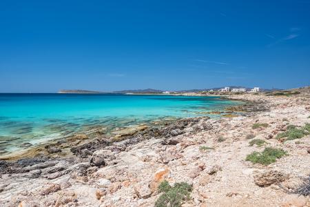 Rocky beach with amazing tranquil water on Paros island, Greece. 写真素材