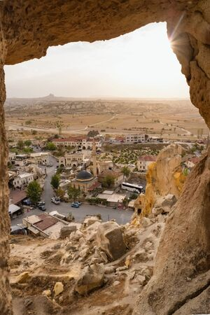 View from the Entrance of the ancient Cavusin fortress and church Vaftizci Yahya, Saint John the Baptist in Cappadocia Imagens - 128570769