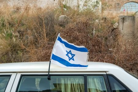 Israeli flag on a car, blue and white Magen David, Israel