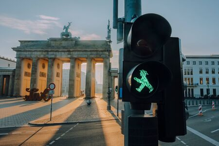 Ampelmann Berlin green traffic light close-up with Brandenburg gate at background