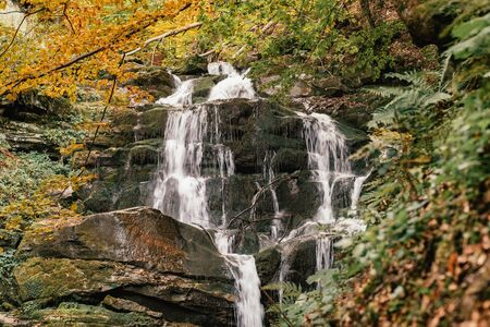 Waterfall Shypit in the autumn forest in Carpathian mountains, Ukraine Фото со стока