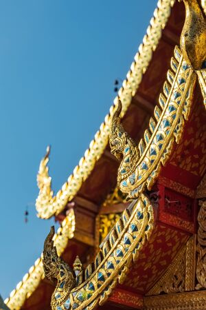 Golden dragon statues on the roof of buddhist temple in Thailand