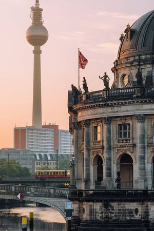 Museum Island on Spree river and tower at background at sunrise in Berlin