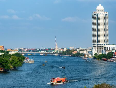 Boats traffic on the Chao Phraya river in Bangkok