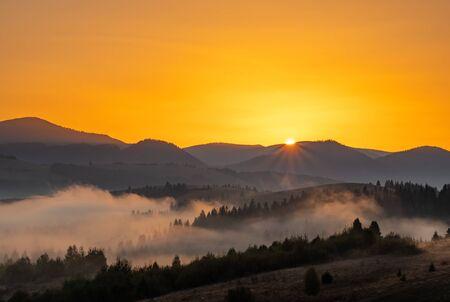 Beautiful autumn landscape at sunrise g in Carpathian mountains, Ukraine Фото со стока