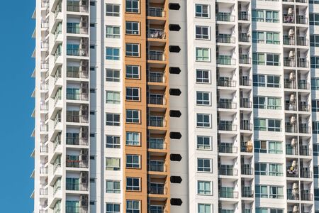 Background texture of many balconies on high-rise apartment building Фото со стока